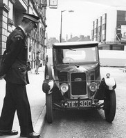 Bolton, Mealhouse Lane, Traffic Warden and old Singer car