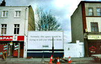 London, Deptford shops and advertising hoarding