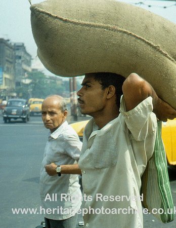 HRS 931 India, Calcutta, street scene man with sack 1995